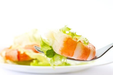 leaves of fresh lettuce with prawns on a white background Stock Photo - 13642814