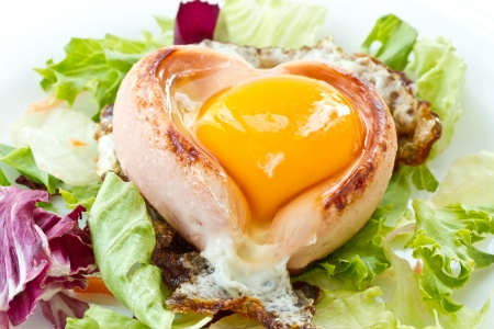 scrambled eggs with sausage on a heart-shaped leaves of lettuce photo