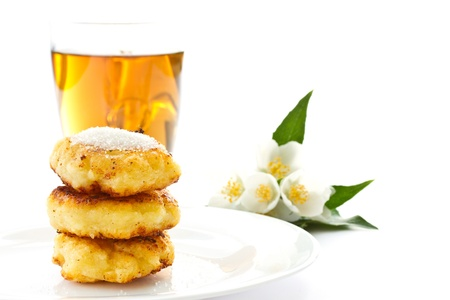 sweet cheese pancakes with sugar on a white background photo