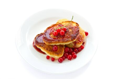 sweet pancakes with jam and red currant photo