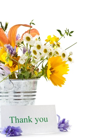 summer bouquet of wild flowers on a white background photo