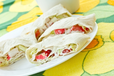 sandwiche: rolls with crab sticks and pita bread with vegetables Stock Photo