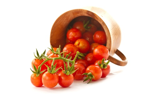 branch of red ripe cherry tomatoes on a white background Stockfoto