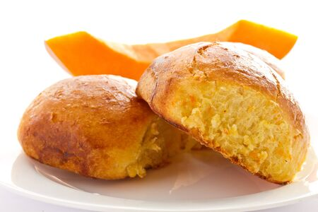 Fresh baked pumpkin buns on a white background photo