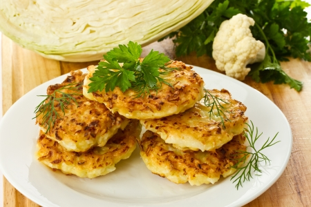 vegetable pancakes with cabbage on a white plate