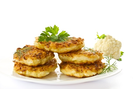 fritter: vegetable pancakes with cabbage on a white plate