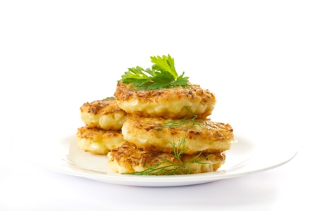 vegetable pancakes with cabbage on a white plate photo
