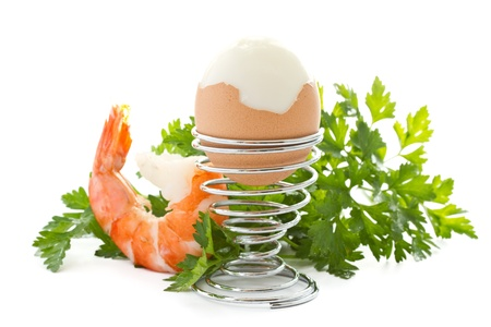 boiled egg with boiled shrimp and greens photo