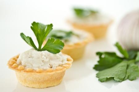 tartlets with twisted bacon on a white background Stock Photo - 16317476