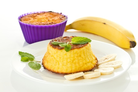 cheese muffins with bananas on a white background photo