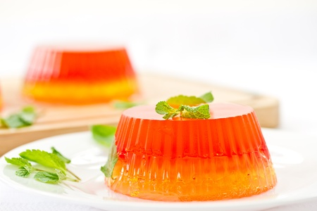 colorful fruit jelly sweets on a white plate Standard-Bild