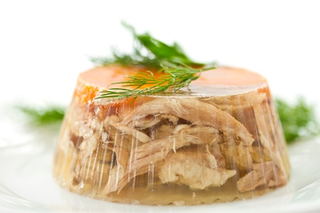 jellied meat and vegetables on a white background photo