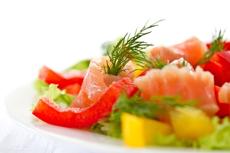 salad with fresh vegetables and salted salmon photo