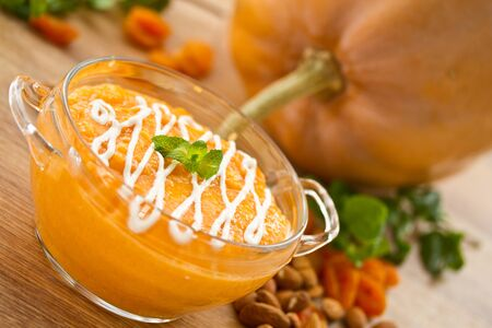 sweet pumpkin porridge background pumpkin and nuts photo