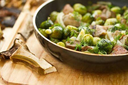 Brussels sprouts roasted with mushrooms and onions photo