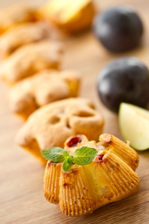 delicious sweet muffins baked with various fruits photo