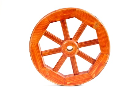 old wooden wheel on a white background photo