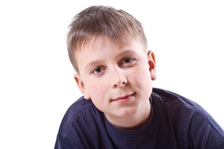 12 13 years: portrait of teenage boy on white background