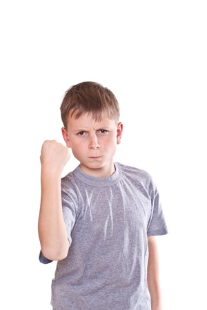 little boy: portrait of an angry teenage boy on white background Stock Photo