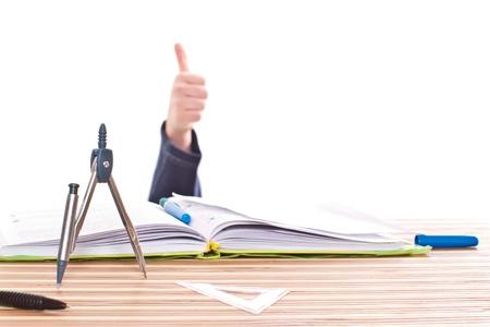 decide: mano que muestra el escenario perfecto para los libros de texto Foto de archivo