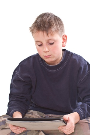 Teen plays on the tablet computer on a white background photo