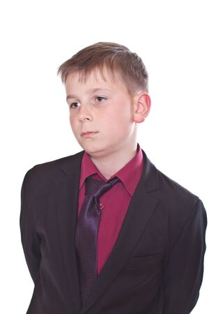 portrait of a teenager in a suit on a white background photo