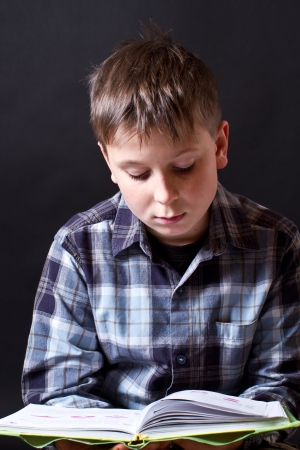 boy with a book on a black background Stock Photo - 16887904