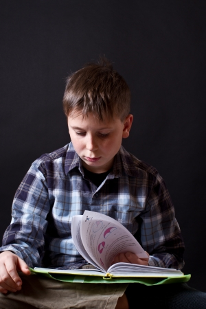 boy with a book on a black background Stock Photo - 16887924