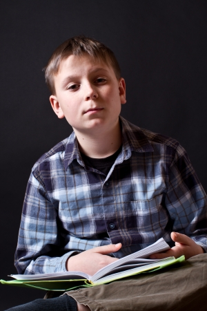 boy with a book on a black background Stock Photo - 16887910
