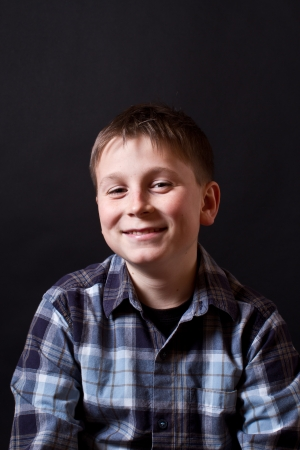 12 13 years: portrait of a teenager on a black background Stock Photo