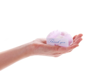 card with gratitude in his hand on a white background photo