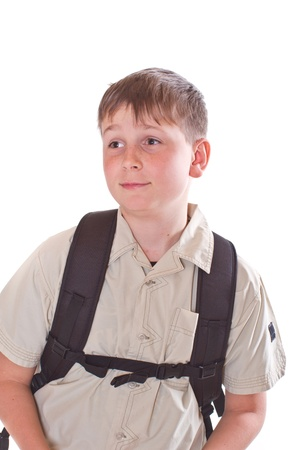 12 13 years: Portrait of a schoolboy with a backpack on a white background