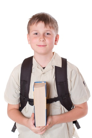 Portrait of a schoolboy with a backpack on a white background photo