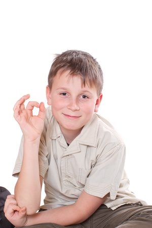 12 13: portrait of a cute boy on white background Stock Photo