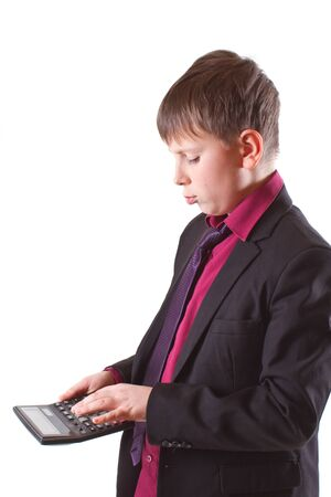 boy with calculator on a white background photo