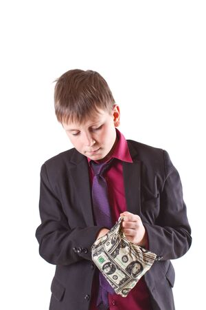 boy looking for money in the bag on a white background photo