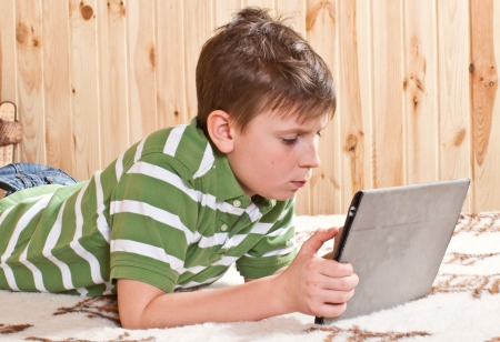 boy teenager with tablet computer Stock Photo - 17413573