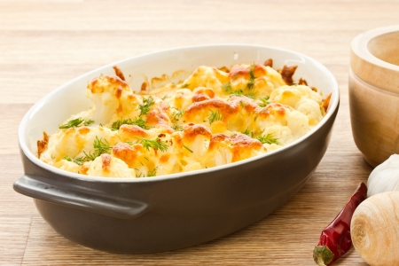 cauliflower baked with egg and cheese with dill Standard-Bild