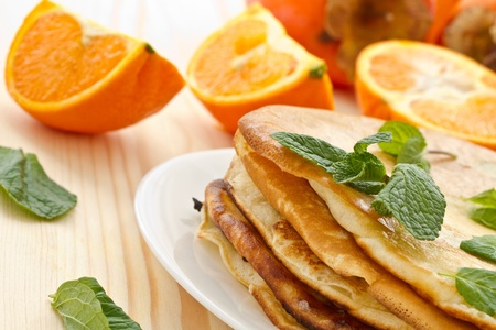stack of pancakes on a plate of various fruits Stock Photo - 17604187