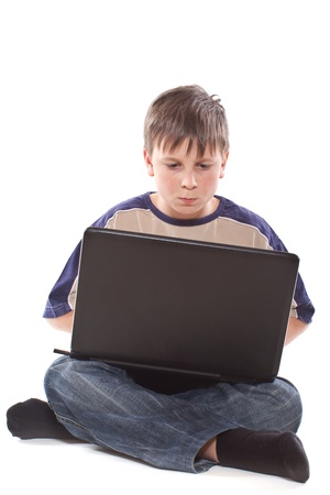 teenage boy with a laptop on a white background photo