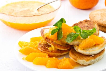 pancakes with orange jam and mint on a plate Stock Photo - 17905641