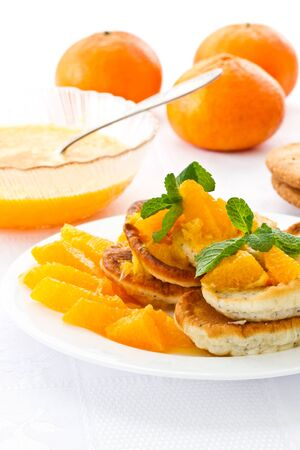 pancakes with orange jam and mint on a plate photo