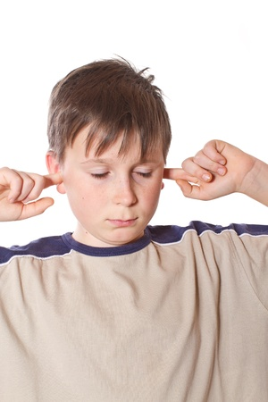 boy with closed ears on a white background photo