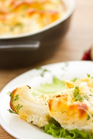 cauliflower baked with egg and cheese with dill photo