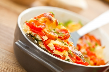 scrambled: different vegetables baked with cheese in the oven Stock Photo