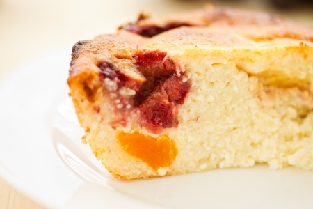 Cottage cheese cake with fruit on a plate Stock Photo - 18296394