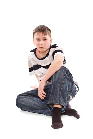 13 14 years: boy sitting on the floor on a white background