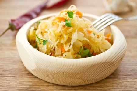 braised: braised cabbage with carrot on a plate