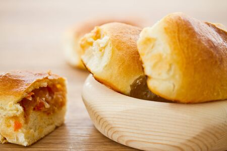 fresh hot Russian pies with cabbage and carrots Stock Photo - 18572292