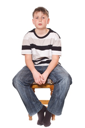 boy sitting on a stool on a white background photo